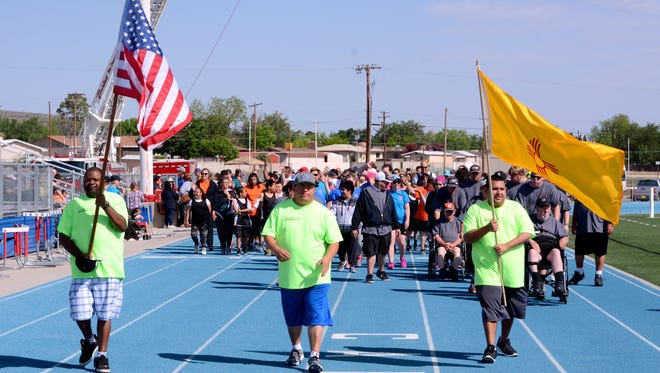 Area IV Special Olympics games athletes walk down the track during the opening ceremony Saturday at Ralph Bowyer Stadium.