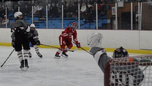 Scarsdale goalie Sam Seltzer gloves a shot from North
