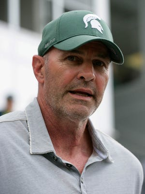 Former Michigan State star Kirk Gibson chats during a 2015 game against Penn State in East Lansing.