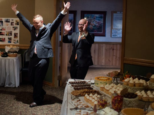 Jon Kayden (left) and Rob Tagatz make a grand entrance at their wedding reception. The two were married in a rush of uncertainty in Brown County on June 9th and celebrated formally at the Swan Club in De Pere on Oct. 10.