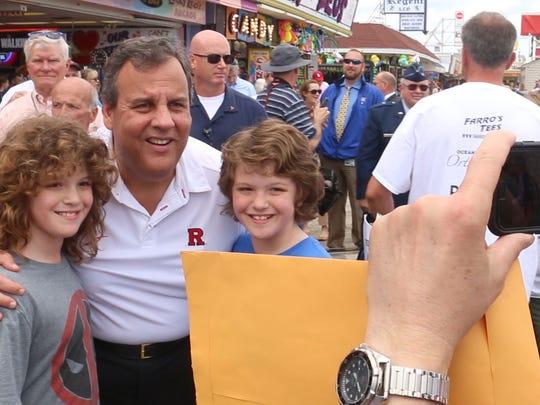 Governor Chris Christie walks the boardwalk in Seaside