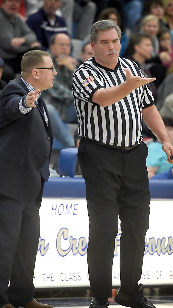 Falcon coach Tom Smith argues the accuracy of a call during tournament play at Cedar Crest High School. The Falcons defeated Camp Hill 58-46 at Cedar Crest High School Tuesday, Dec. 29.