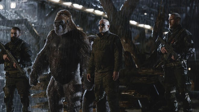"""Woody Harrelson, center, in a scene from """"War for the Planet of the Apes."""""""