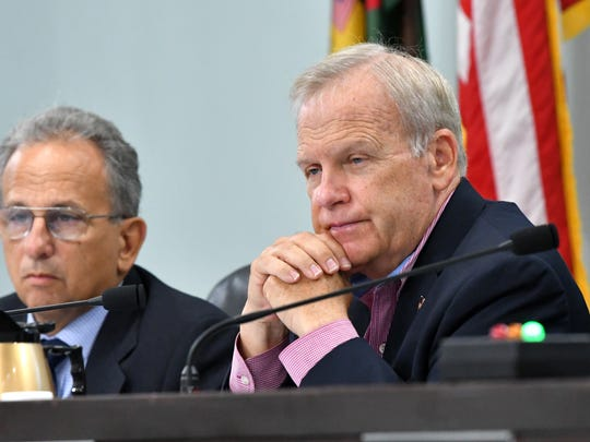 Brevard County Commissioner Curt Smith, at right, sponsored the measure to allow up to $1 million a year in Tourist Development Tax money to be used for Indian River Lagoon projects. Seated next to Smith at Tuesday's County Commission meeting is County Manager Frank Abbate.