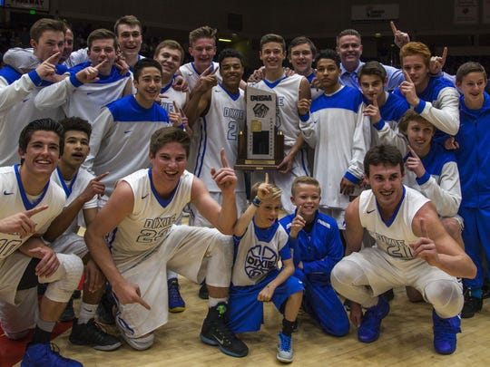 Dixie playesr pose a photo with the 3A championship trophy after defeating Juan Diego 65-57, Feb. 27, 2016.