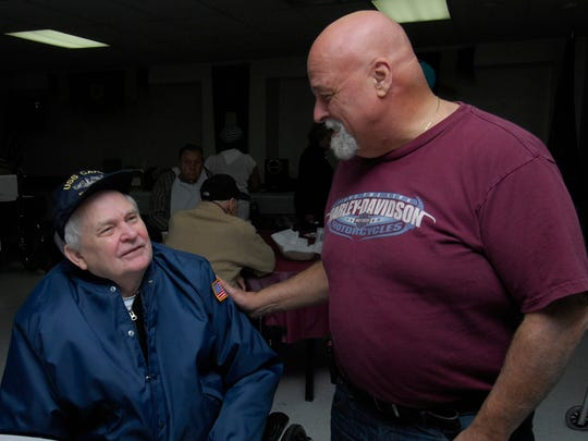Teaneck Veterans of Foreign Wars Commander Leonard Hennig, right, greets Leo Jacobs, a fellow veteran, at a luncheon hosted by the American Legion and the VFW in 2009. Hennig was one of several residents chosen to receive a gift card as The Record's A Very Giving Thanksgiving award for 2017.