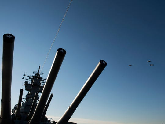 Three World War II-era planes soar over the USS New Jersey during a flyby honoring the 76th anniversary of the attack on Pearl Harbor Thursday, Dec. 7, 2017 in Camden.
