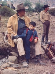 John Wayne and son Ethan relaxing on the set of 'The