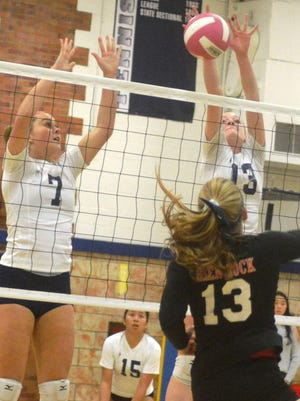 Rutherford junior Caroline Fisher (7) and sophomore Jenna Rogers going up for the block against Glen Rock.