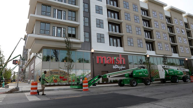 Construction continues May 12, 2014, on the new 40,000-square-foot Marsh grocery on the street level of the Axis apartment-retail complex at the corner of Michigan Street and Senate Avenue, Indianapolis.