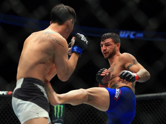 Cub Swanson (R) kicks Doo Ho Choi in their Featherweight bout during the UFC 206 event at Air Canada Centre on Dec. 10, 2016 in Toronto, Canada.