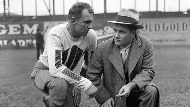 Alabama coach Frank Thomas, right, talks with player Foy Leach in 1933. Alabama won the first SEC title in 1933.
