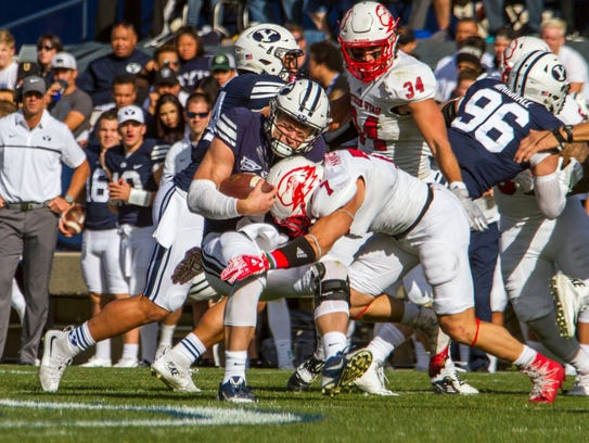 Southern Utah safety Kyle Hanneman (7) tackles Brigham