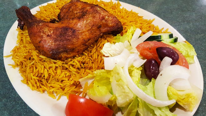 Chicken Kebsa with yellow rice ($10.95) from International Delights Cafe. Kebsa is also available with a choice of lamb ($16.95) or white rice.