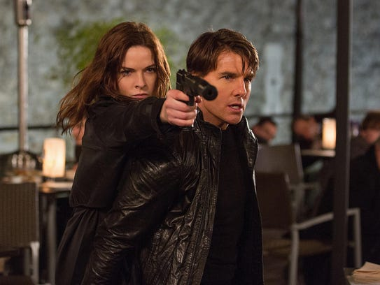 "Rebecca Ferguson and Tom Cruise in a scene from ""Mission"