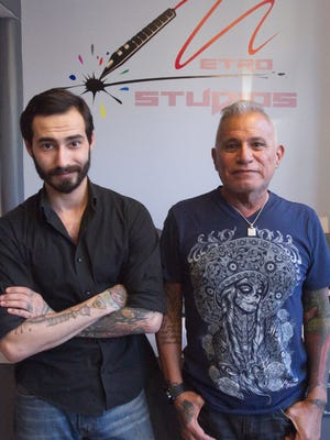 Co-owners Igor Kocherga, left, and Rafael Huizar have opened Metro Studios, a tattoo shop in downtown Howell.
