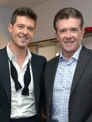 Alan Thicke and son Robin Thicke in December 2013.