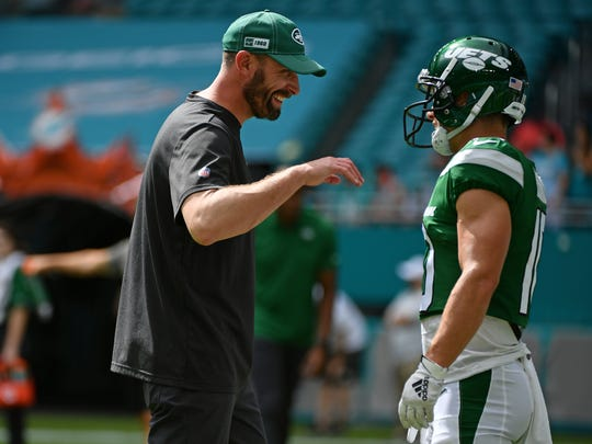 Nov 3, 2019; Miami Gardens, FL, USA; New York Jets head coach Adam Gase talks with New York Jets wide receiver Braxton Berrios (10) prior to the game against the Miami Dolphins at Hard Rock Stadium. Mandatory Credit: Jasen Vinlove-USA TODAY Sports
