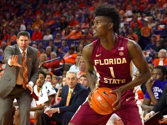 Florida State frehsman forward Jonathan Isaac (1) and