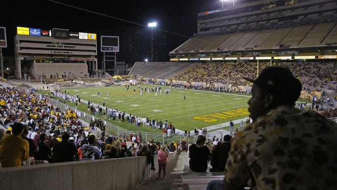 Fans watch the Arizona State football team in their annual spring game at Sun Devil Stadium on April 10. Sun Devil Stadium is under construction, and the team will move to the west sideline this season.