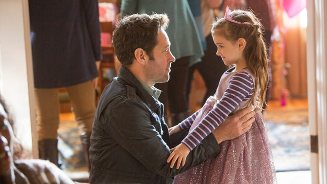 "Saving the world is fine but Scott Lang (Paul Rudd) also yearns to reconnect with his daughter (Abby Ryder Fortson) in ""Ant-Man."""