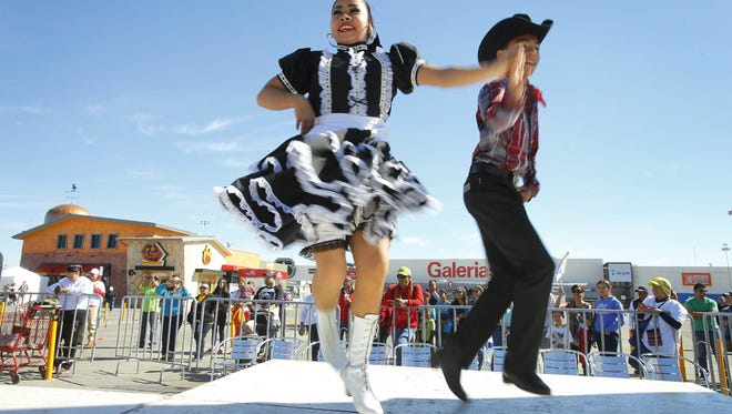 Mexican Folklorico dance group Xochipilli performs along the route Pope Francis will travel Wednesday, Feb. 17, 2016, in Juárez, Mexico.