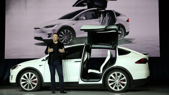 Tesla CEO Elon Musk speaks during an event to launch the new Tesla Model X Crossover SUV on September 29, 2015 in Fremont, California.