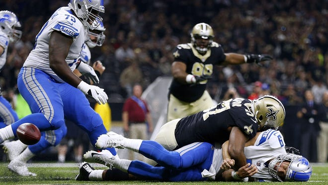 Saints' Alex Okafor gets past Greg Robinson (73) to force a fumble on Matthew Stafford in the first quarter that was recovered for a Saints touchdown at the Mercedes-Benz Superdome on October 15, 2017 in New Orleans.