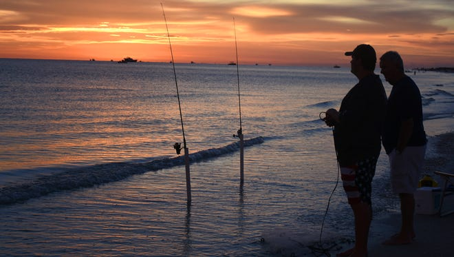 In this file photo, Hunter Bogg fishes while waiting for fireworks on Marco Island.