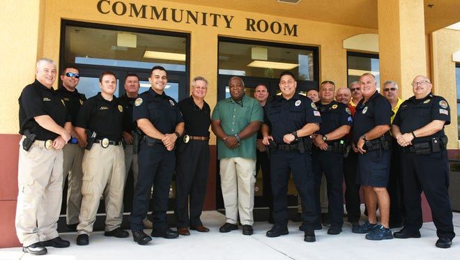 Members of the Marco Island Police Department pose for a photo last year after the hiring of a new crop of officers.