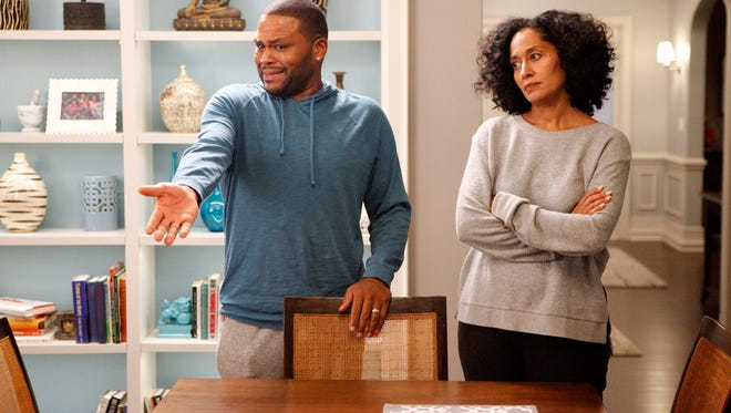 """Anthony Anderson (L) and Tracee Ellis Ross appear in a scene from """"Black-ish."""" The series was created by Kenya Barris."""