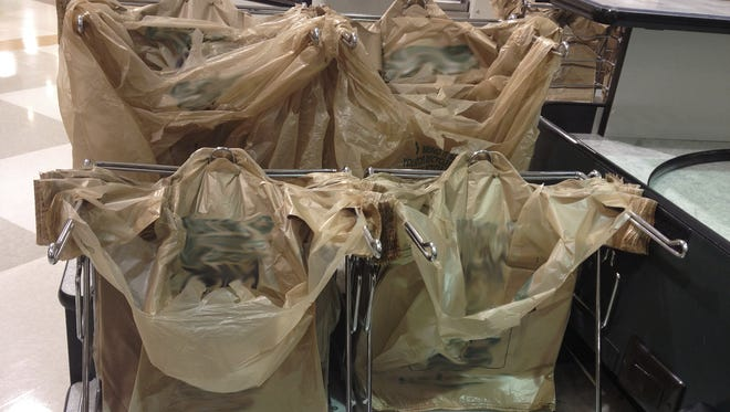 The Legislature has passed two measures revising state law to get around a lawsuit over bans on plastic bags and disposable products.