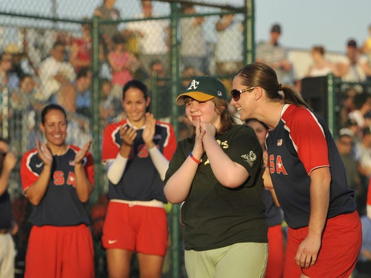 USA's Lauren Lappin and Miracle League player Cassandra