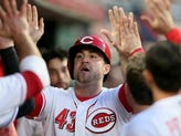 Cincinnati Reds right fielder Scott Schebler (43) is congratulated in the dugout after scoring in the fifth inning during the National League baseball game between the Atlanta Braves and the Cincinnati Reds, Wednesday, April 25, 2018, at Great American Ball Park in Cincinnati.