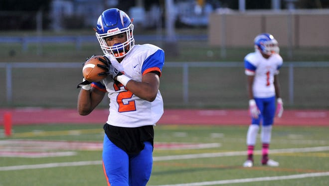 Millville's Marcial Ramos throws while warming up before playing Bridgeton Friday, Oct. 21 in Bridgeton.  Ramos has been taking snaps at quarterback for the Thunderbolts.