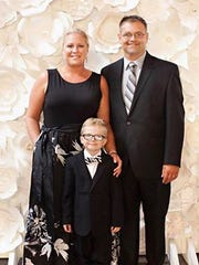 Molly Mahaffey-Montgomery poses for a picture with husband Chuck and son Max.