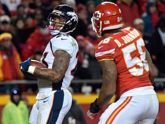 Denver Broncos running back Devontae Booker (23) scores a touchdown in front of Kansas City Chiefs linebacker Derrick Johnson (56) during the second half of an NFL football game in Kansas City, Mo., Monday, Oct. 30, 2017. (AP Photo/Ed Zurga)
