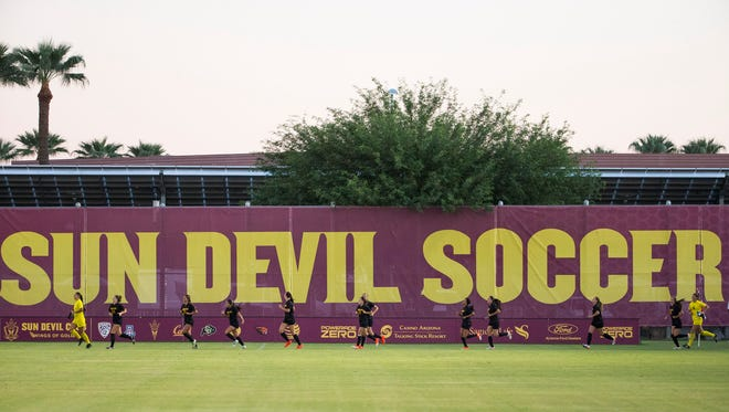 ASU soccer players run onto the field before playing Denver University at Sun Devil Soccer Stadium in Tempe September 4, 2016. ASU lost 3-1.
