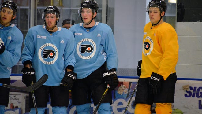 Nolan Patrick, middle, will be the center of attention in his first training camp with the Flyers.