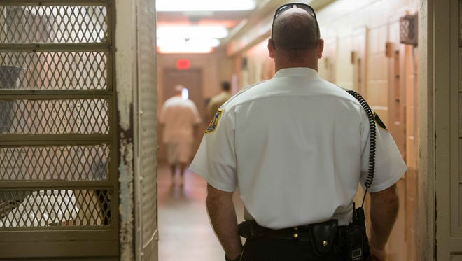 Delaware Correctional Lt. Brian Reynolds stands guard in the medium security cell area at the James T. Vaugh Correctional Center in Smyrna on Oct. 8, 2015. Delaware has a new project to ensure that no one is serving time in a state prison if there is evidence that establishes their innocence.