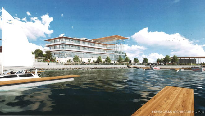 A four-story building with condos, offices and a restaurant is being proposed for downtown Port Washington's lakefront.