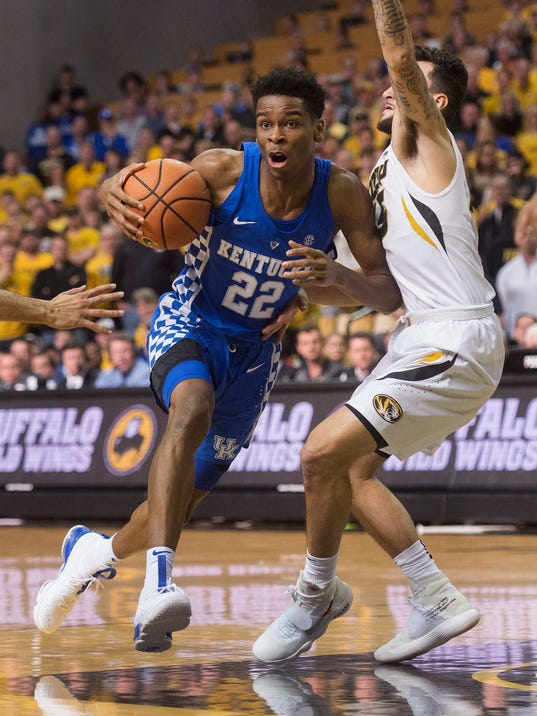 Kentucky's Shai Gilgeous-Alexander, left, dribbles around Missouri's Jordan Geist, right, during the first half of an NCAA college basketball game Saturday, Feb. 3, 2018, in Columbia, Mo. (AP Photo/L.G. Patterson)