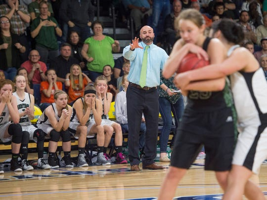 Heritage Christian School coach Joe Packard and the Eagles bench react to a play in the final moments of a CHSAA 1A State Semifinal game against Fleming at Bank of Colorado Arena in Greeley on Friday, March 10, 2017.