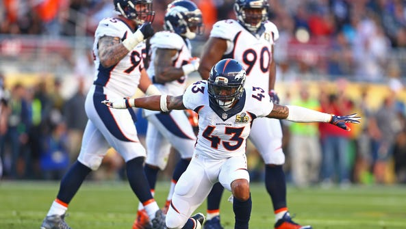 Broncos safety T.J. Ward (43) celebrates a play against