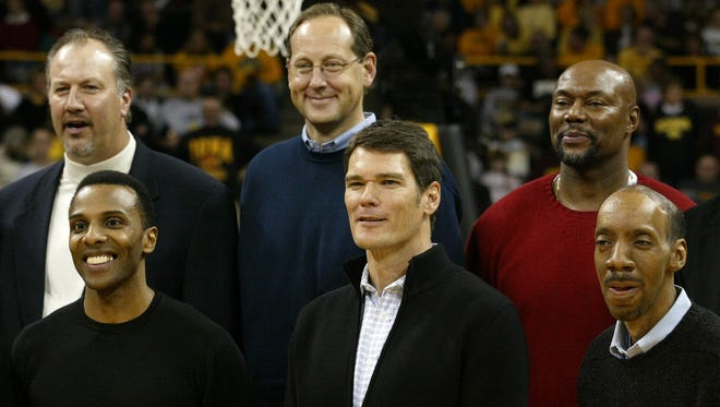 Members of Iowa's 1980 Final Four team were honored at Carver-Hawkeye Arena in 2005. In front, from left, Ronnie Lester, Jon Darsee and Kenny Arnold and in back, from left, Mike Heller, Steve Waite and Vince Brookins.