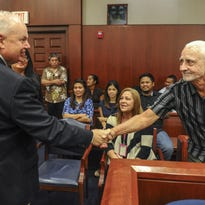 Plantiff Arnold Davis, right, shakes hands with Ninth Circuit Court of Appeals Circuit Judge N. Randy Smith prior to the start of an appeal cases hearing at the U.S. District Court in Hagatna on Aug. 27.