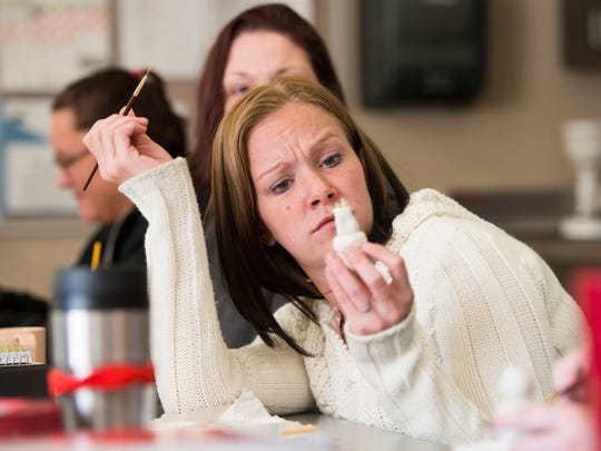Melissa Brodie paints crafts during a group session at the Larimer County Community Corrections Facility in Fort Collins on Dec. 18, 2015.