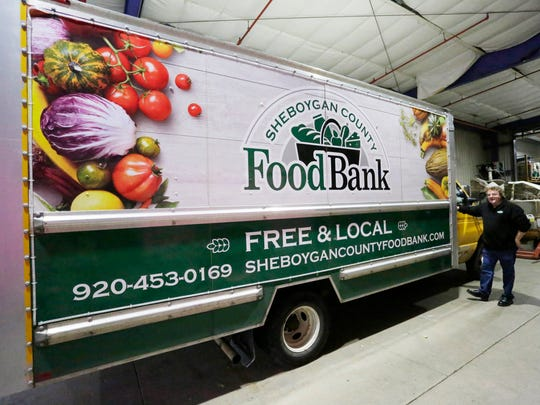 Sheboygan County Food Bank Executive Director Patrick Boyle stands by the organization's truck they use to transport and obtain food for the county's food banks, Tuesday, November 28, 2017, in Sheboygan, Wis.