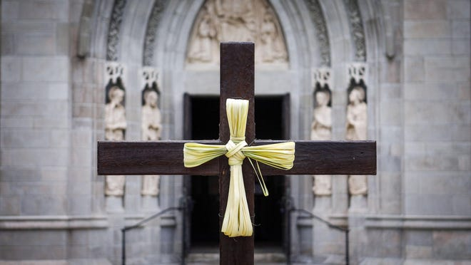 A cross made of palms is stationed outside The Church of Bethesda-by-the-Sea on Palm Sunday, April 5, 2020.  [Damon Higgins/palmbeachdailynews.com]\r\r\r