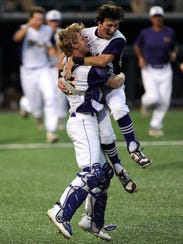 Wylie catcher Caleb Munton (25) celebrates with teammate